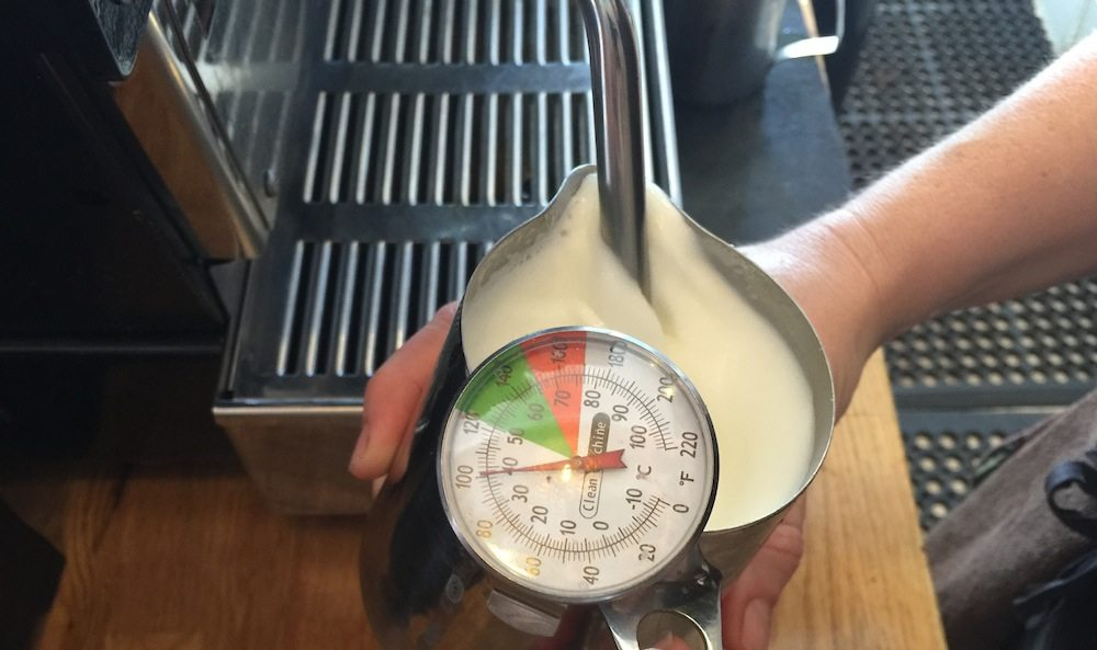 texturing milk with thermometer