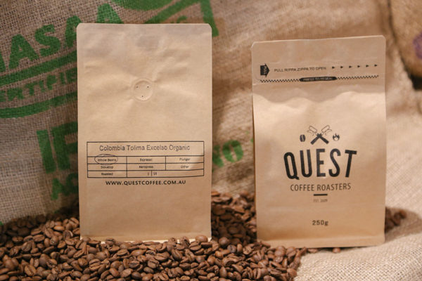 Bags of Quest's limited release Colombia Excelso Tolima Organic SO - Medium-Dark Roast Coffee