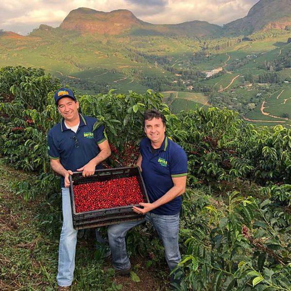 Brazil Fazendas Dutra farmers with box of coffee cherries