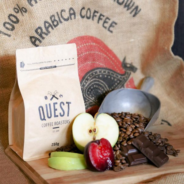 Australian Eureka Organic coffee beans with green apple, plum, and dark chocolate tasting notes